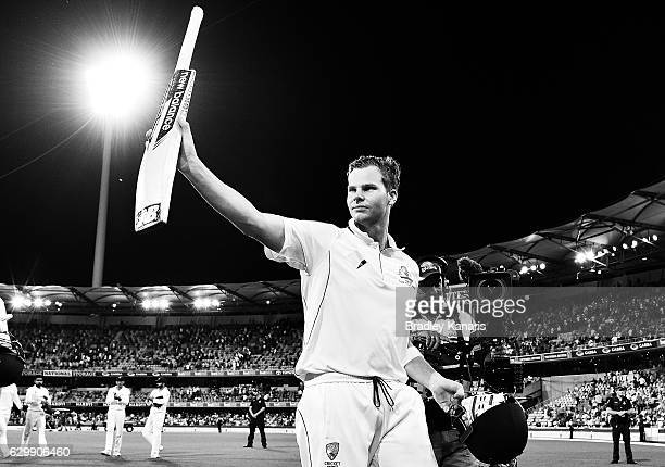 Steve Smith of Australia acknowledges the crowd as he walks from the field during day one of the First Test match between Australia and Pakistan at...