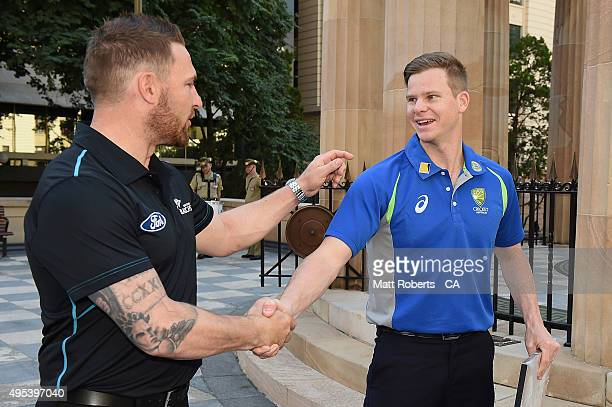 Steve Smith of Australia and Brendon McCullum of New Zealand shake hands after a visit to the Brisbane War Memorial on November 3 2015 in Brisbane...
