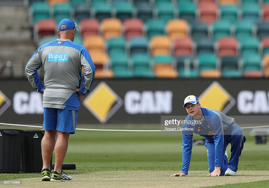 Steve Smith of Australia and Darren Lehmann, coach of Australia, check the pitch during the Australian nets session at Blundstone Arena on November 11, 2016 in Hobart, Australia.