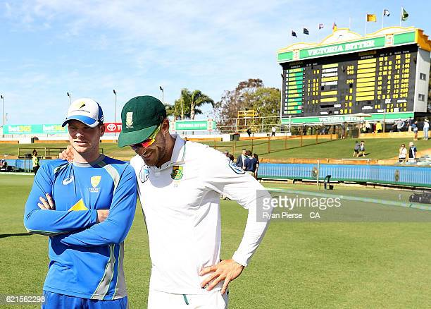Steve Smith of Australia and Faf du Plessis of South Africa talk after day five of the First Test match between Australia and South Africa at WACA on...
