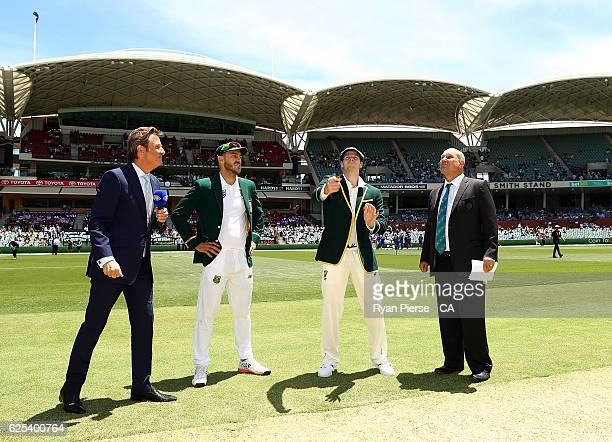 Steve Smith of Australia and Faf du Plessis of South Africa toss the coin during day one of the Third Test match between Australia and South Africa...