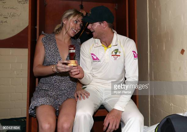 Steve Smith of Australia and his fiance Danielle Willis pose with the Ashes Urn in the change rooms after day five of the Fifth Test match in the...