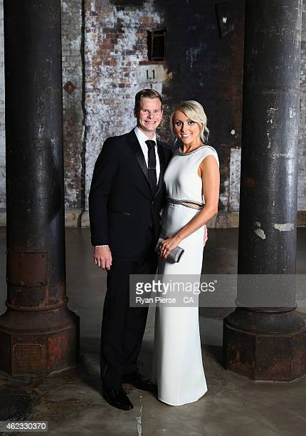 Steve Smith of Australia and his partner Dani Willis pose ahead of the 2015 Allan Border Medal at Carriageworks on January 27, 2015 in Sydney,...
