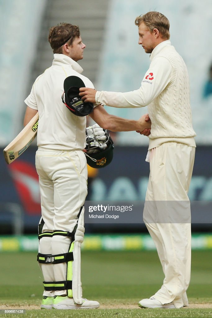 Steve Smith of Australia (L) and Joe Root of England shake hands after the drawn result during day one of the Fourth Test Match in the 2017/18 Ashes series between Australia and England at Melbourne Cricket Ground on December 30, 2017 in Melbourne, Australia.