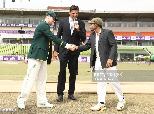 Steve Smith of Australia and Mushfiqur Rahim of Bangladesh are seen at the coin toss during day one of the First Test match between Bangladesh and...