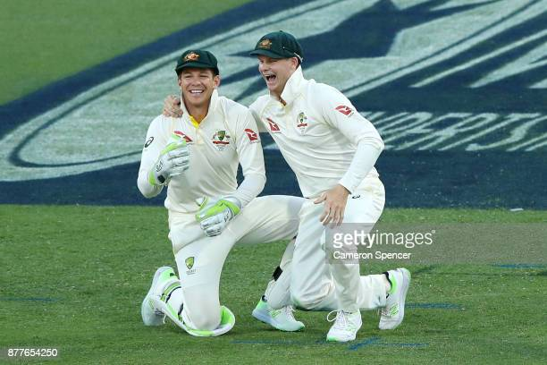 Steve Smith of Australia and Tim Paine of Australia fall over each other fielding during day one of the First Test Match of the 2017/18 Ashes Series...