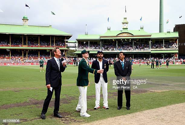 Steve Smith of Australia and Virat Kohli of India toss the coin during day one of the Fourth Test match between Australia and India at Sydney Cricket...