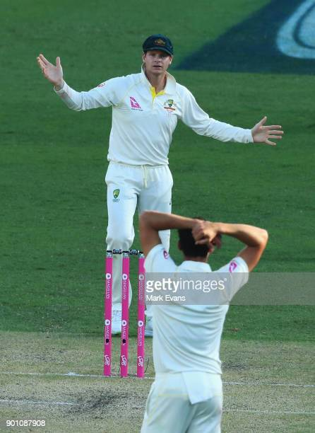 Steve Smith of Australia asks Mitch Starc if he wants a referral during day one of the Fifth Test match in the 2017/18 Ashes Series between Australia...
