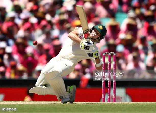 Steve Smith of Australia avoids a short ball from Stuart Broad of England during day three of the Fifth Test match in the 2017/18 Ashes Series...