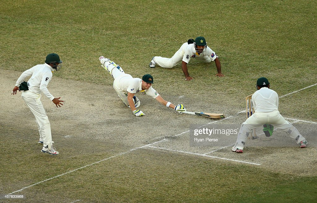Steve Smith of Australia avoids being run out during Day Four of the First Test between Pakistan and Australia at Dubai International Stadium on October 25, 2014 in Dubai, United Arab Emirates.