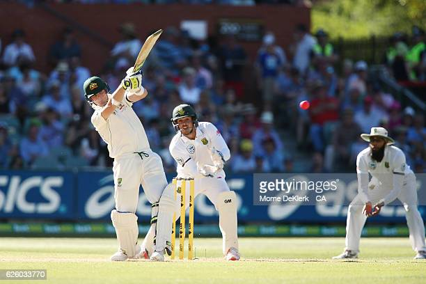 Steve Smith of Australia bats in front of Quinton de Kock of South Africa during day four of the Third Test match between Australia and South Africa...