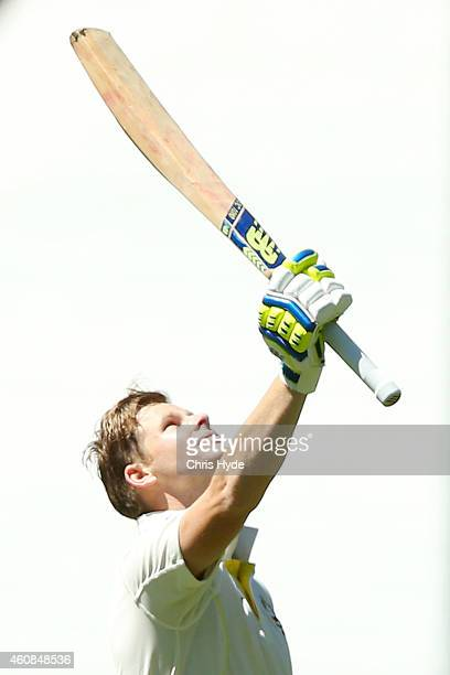 Steve Smith of Australia celebrates a century during day two of the Third Test match between Australia and India at Melbourne Cricket Ground on...
