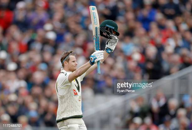 Steve Smith of Australia celebrates after reaching his century during day two of the 4th Specsavers Test between England and Australia at Old...