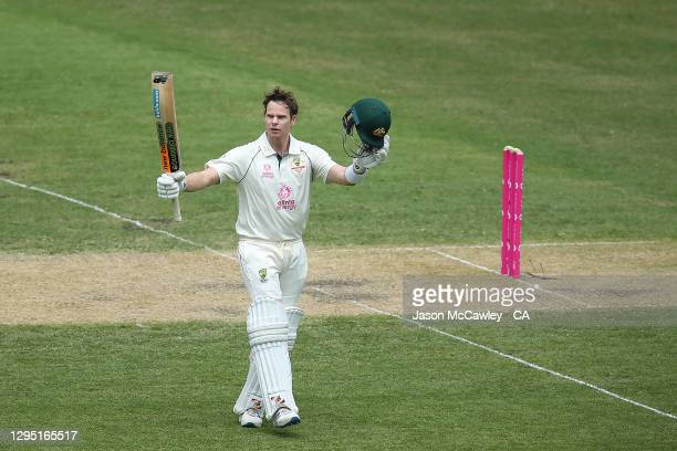 Steve Smith of Australia celebrates after reaching his century during day two of the 3rd Test match in the series between Australia and India at...