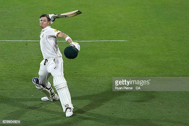 Steve Smith of Australia celebrates after reaching his century during day one of the First Test match between Australia and Pakistan at The Gabba on...