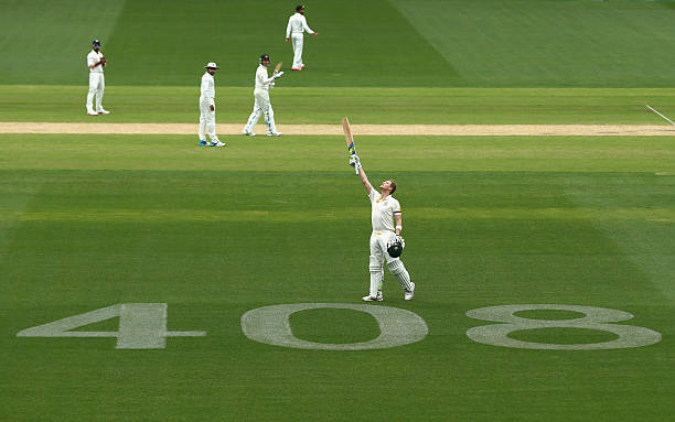 Steve Smith of Australia celebrates after reaching his century over the Test Cap number '408' tribute to the late Phil Hughes during day two of the...