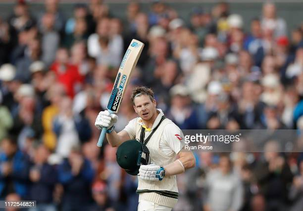 Steve Smith of Australia celebrates after reaching his double century during day two of the 4th Specsavers Test between England and Australia at Old...