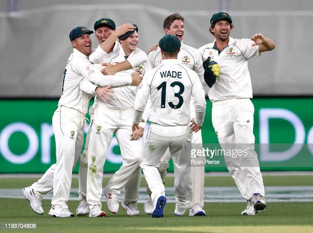 Steve Smith of Australia celebrates after taking a catch to dismiss Kane Williamson of New Zealand off the bowling of Mitchell Starc of Australia...