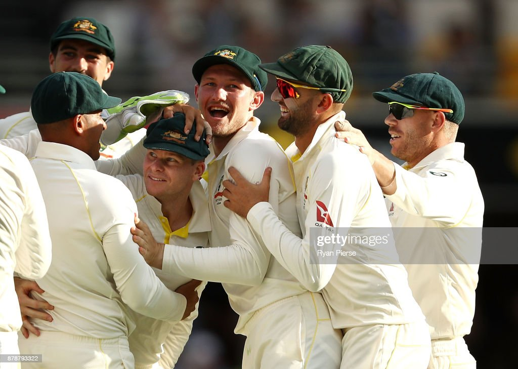 Steve Smith of Australia celebrates after taking a catch to dismiss James Vince of England off the bowling of Josh Hazlewood of Australia during day three of the First Test Match of the 2017/18 Ashes Series between Australia and England at The Gabba on November 25, 2017 in Brisbane, Australia.