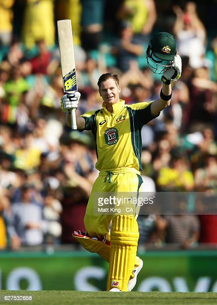 Steve Smith of Australia celebrates and acknowledges the crowd after scoring a century during game one of the One Day International series between...