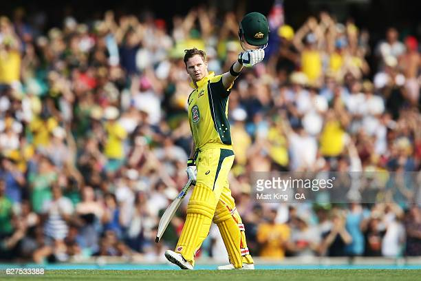 Steve Smith of Australia celebrates and acknowledges the crowd after scoring 150 during game one of the One Day International series between...