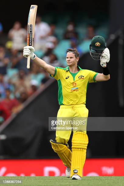 Steve Smith of Australia celebrates making 100 runs during game two of the One Day International series between Australia and India at Sydney Cricket...