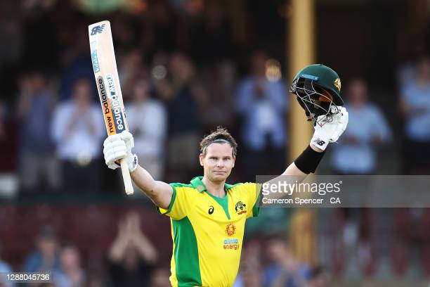Steve Smith of Australia celebrates scoring a century during game one of the One Day International series between Australia and India at Sydney...