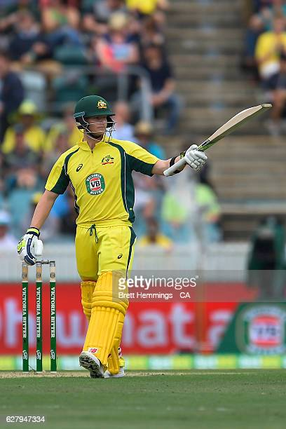 Steve Smith of Australia celebrates scoring his half century during game two of the One Day International series between Australia and New Zealand at...