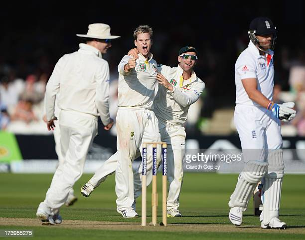 Steve Smith of Australia celebrates the wicket of Matt Prior of England with Phil Hughes during day one of the 2nd Investec Ashes Test match between...