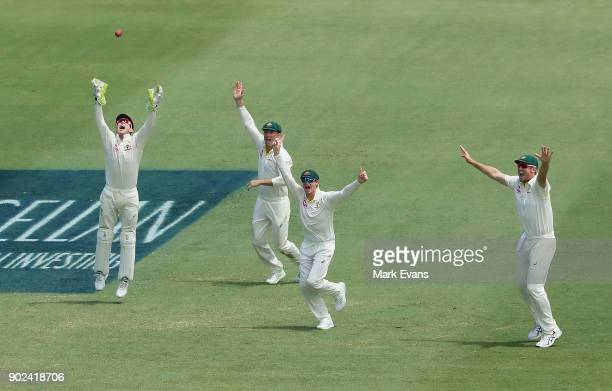 Steve Smith of Australia celebrates with team mates as Australia win the Ashes during day five of the Fifth Test match in the 2017/18 Ashes Series...