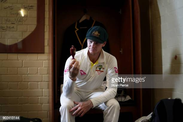 Steve Smith of Australia celebrates with the Ashes Urn in the change rooms during day five of the Fifth Test match in the 2017/18 Ashes Series...