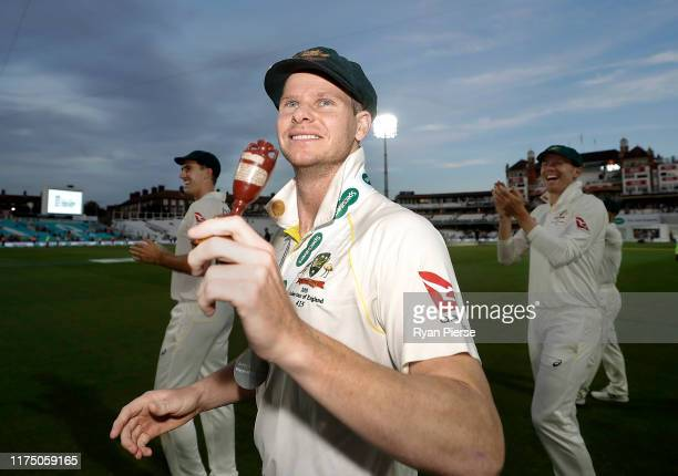 Steve Smith of Australia celebrates with the Urn after Australia drew the series to retain the Ashes during day four of the 5th Specsavers Ashes Test...