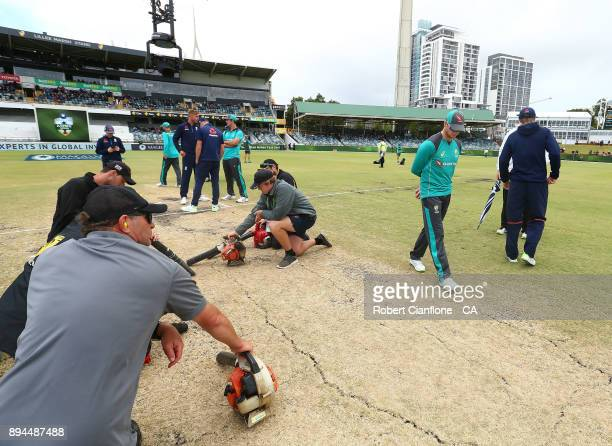 Steve Smith of Australia checks the pitch as the groundsmen dry the pitch during day five of the Third Test match during the 2017/18 Ashes Series...