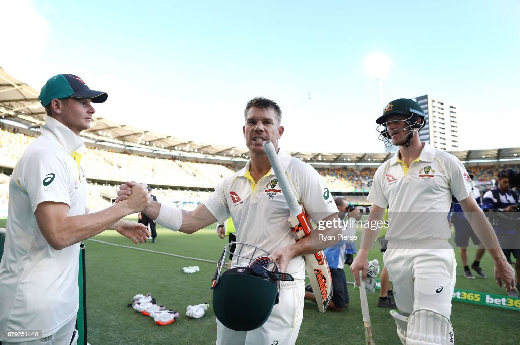 Steve Smith of Australia congratulates David Warner and Cameron Bancroft of Australia as they walk from the ground at stumps during day four of the First Test Match of the 2017/18 Ashes Series between Australia and England at The Gabba on November 26, 2017 in Brisbane, Australia.