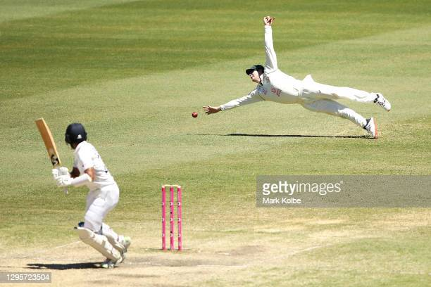 Steve Smith of Australia dives for the ball of the edge of Cheteshwar Pujara of India during day five of the Third Test match in the series between...