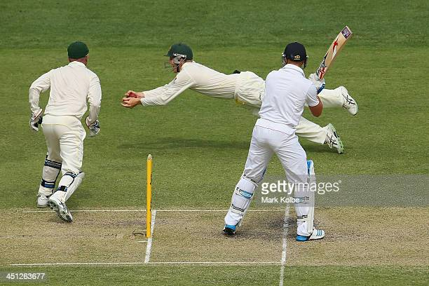 Steve Smith of Australia dives to take the catch to remove Matt Prior of England during day two of the First Ashes Test match between Australia and...