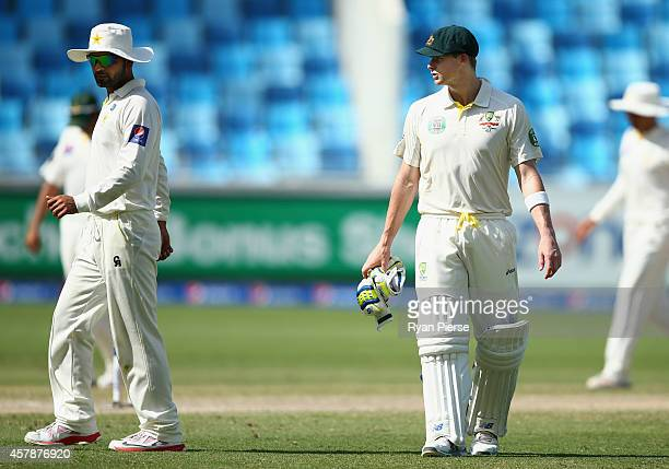 Steve Smith of Australia has words with Ahmed Shehzad of Pakistan after he dropped a catch hit by Mitchell Johnson of Australia during Day Five of...