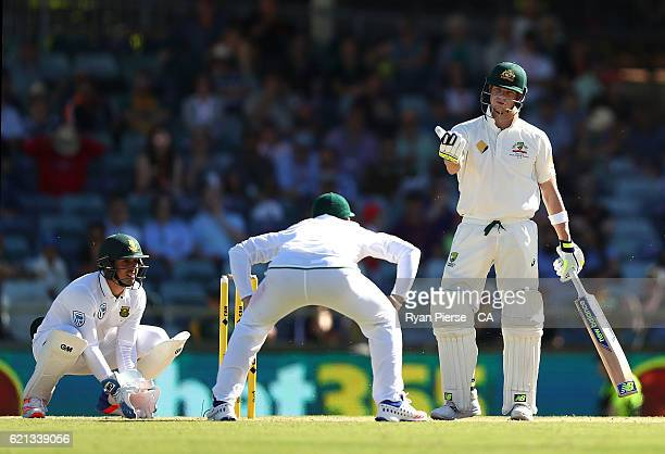 Steve Smith of Australia has words with Dean Elgar of South Africa during day four of the First Test match between Australia and South Africa at WACA...