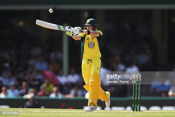 Steve Smith of Australia hits for six during game one of the One Day International series between Australia and New Zealand at Sydney Cricket Ground...