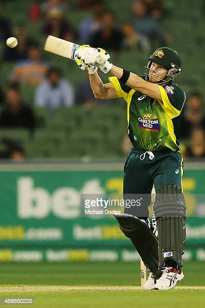 Steve Smith of Australia hits the ball back over the bowler or a boundary during game four of the One Day International series between Australia and...