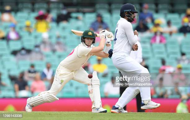 Steve Smith of Australia hits the ball past Hanuma Vihari of India during day two of the third Test match between Australia and India at Sydney...