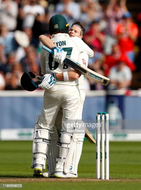 Steve Smith of Australia is congratulated by Nathan Lyon of Australia after reaching his century during Day One of the 1st Specsavers Ashes Test...