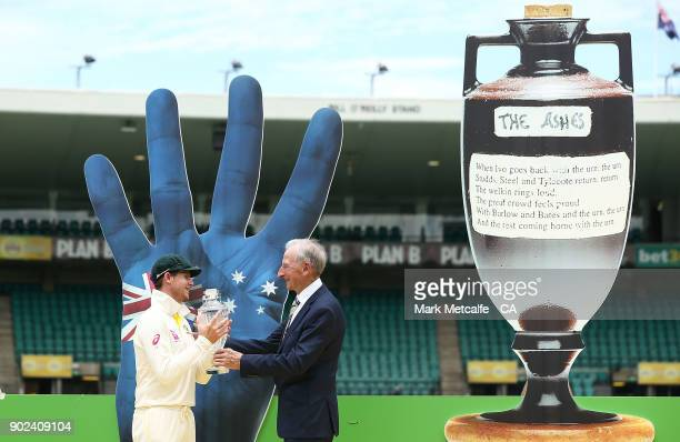 Steve Smith of Australia is presented with the Ashes trophy by Bill Lawry after winning the Ashes during day five of the Fifth Test match in the...