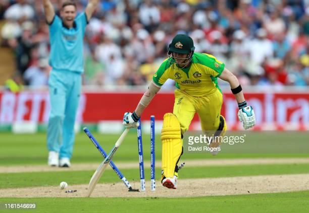 Steve Smith of Australia is run out by a throw from England wicket keeper Jos Buttler during the SemiFinal match of the ICC Cricket World Cup 2019...