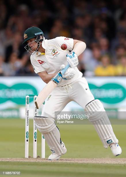 Steve Smith of Australia is struck by a delivery from Jofra Archer of England during day four of the 2nd Specsavers Ashes Test between England and...