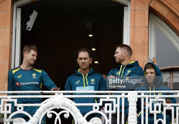 Steve Smith of Australia, Justin Langer, coach of Australia, David Warner and Tim Paine of Australia look on as rain delays the start of play during...