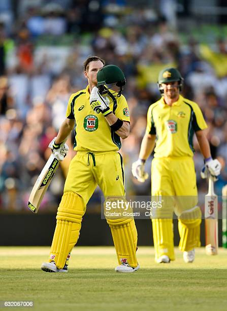 Steve Smith of Australia kisses his helmet after scoring a century during game three of the One Day International series between Australia and...