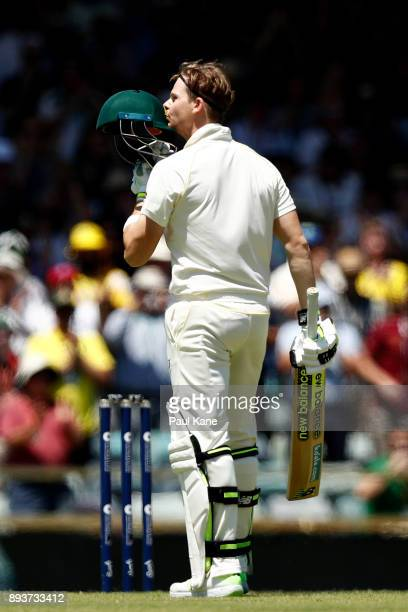 Steve Smith of Australia kisses the coat of arms on his helmet after scoring his century during day three of the Third Test match during the 2017/18...