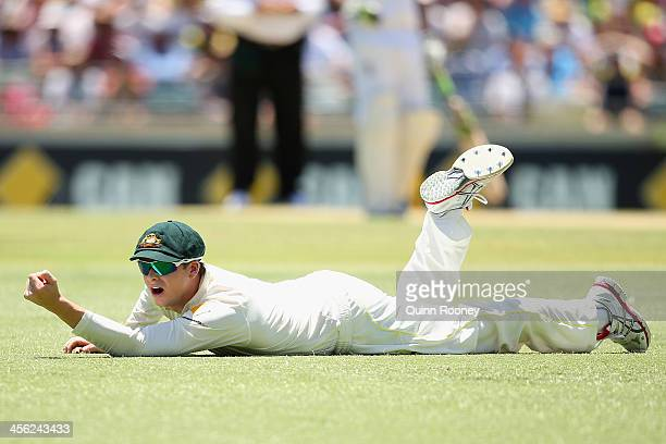 Steve Smith of Australia lays on the ground after diving for a catch off the batting of Alastair Cook of England during day two of the Third Ashes...