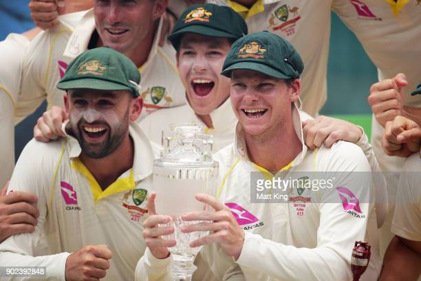 Steve Smith of Australia lifts the Ashes Trophy during day five of the Fifth Test match in the 2017/18 Ashes Series between Australia and England at...